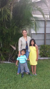 Ninfa and family in front of house #1