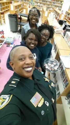 Palm Beach County Sheriff's Office Lieutenant Pat Brown with some of her Take Stock in Children mentees. She calls them Pat's Angels.
